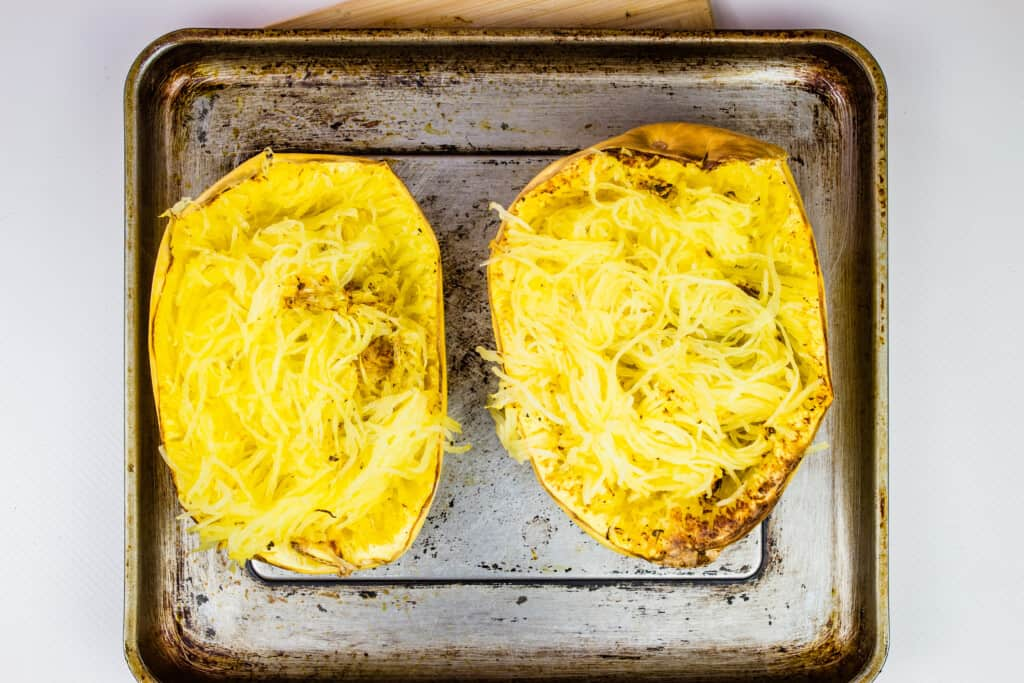 spaghetti squash on a tray that's been fluffed with a fork
