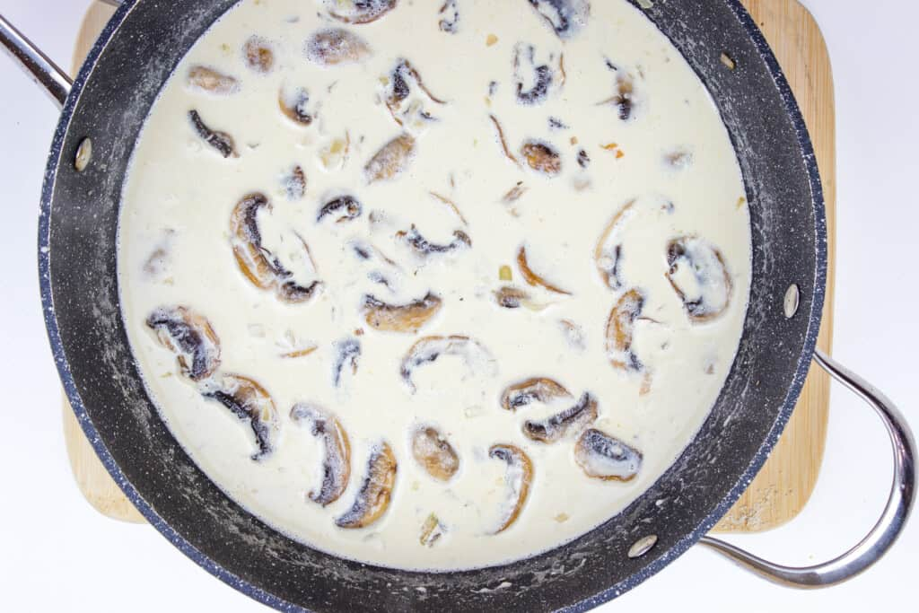 the keto chicken marsala sauce in a skillet.
