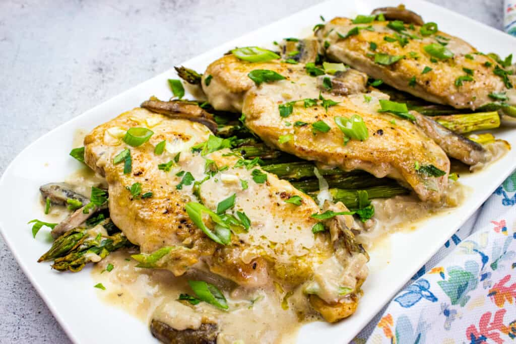 creamy keto chicken marsala on a white platter