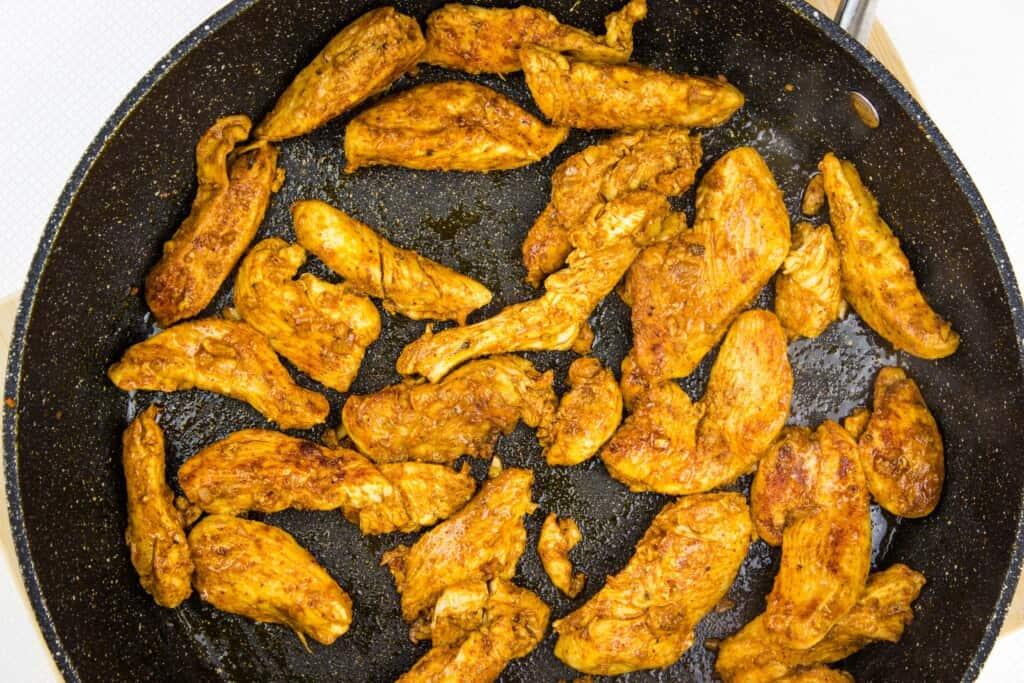 sauteeing the chicken for keto chicken fajita skillet