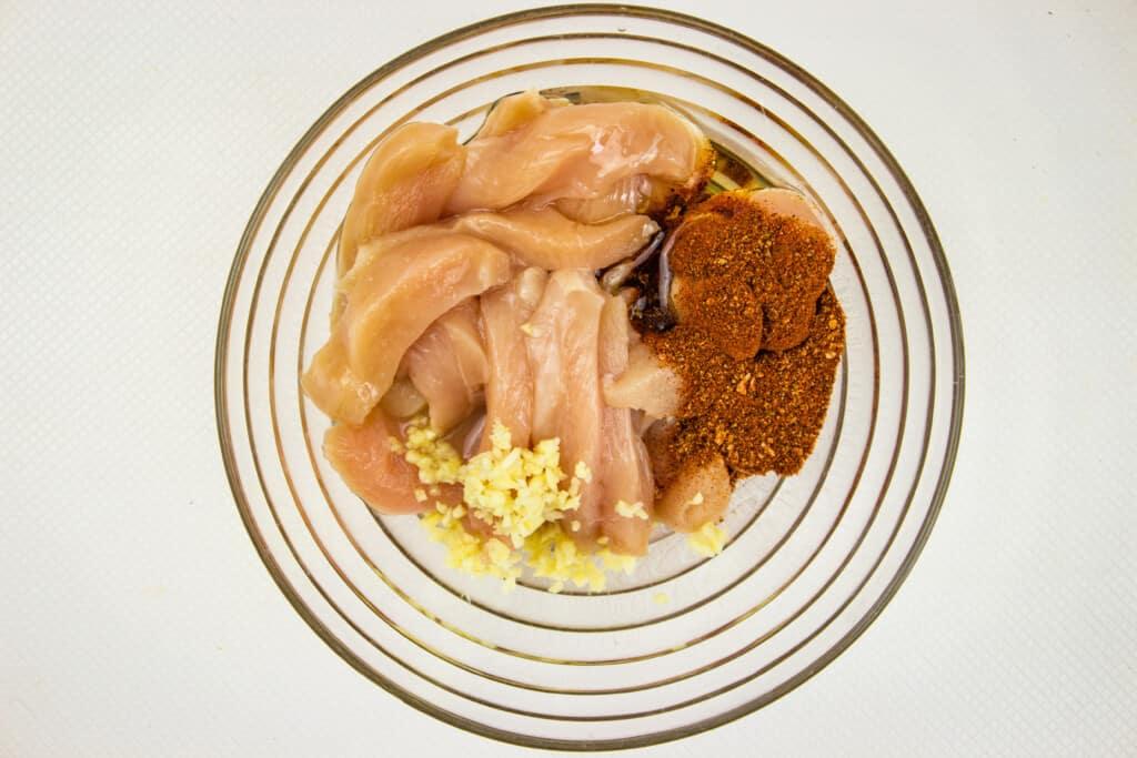 Mix the chicken with the garlic and fajita seasoning