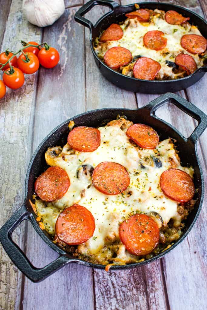 keto pizza casserole in round cast iron dishes