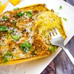 air fryer spaghetti squash with parmesan with a fork on a platter