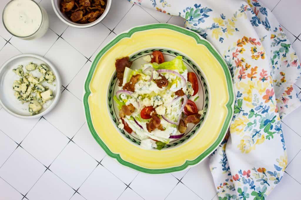 keto wedge salad on a yellow plate