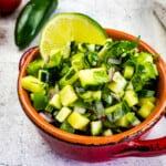 keto cucumber salsa in a cute red dish