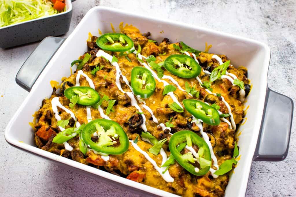 beefy keto taco casserole in a square casserole dish