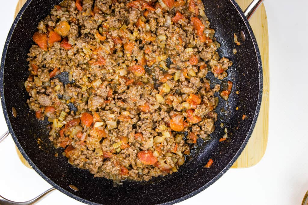 Add tomatoes to the filling and cook down