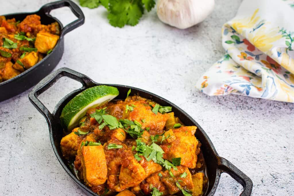 keto chicken chili in small black dishes