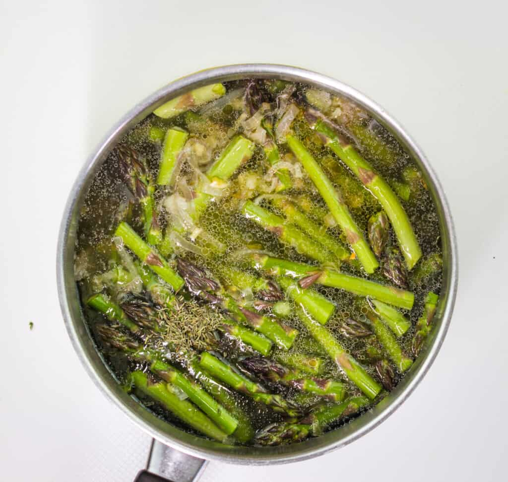 simmering asparagus in stock