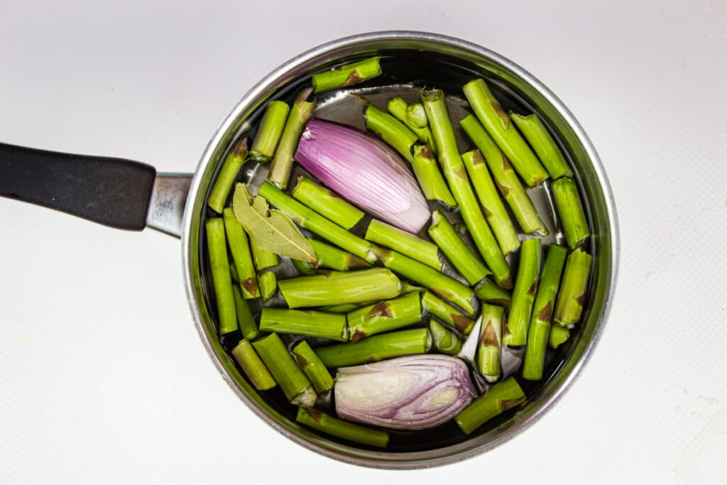 making the broth with asparagus ends and shallot