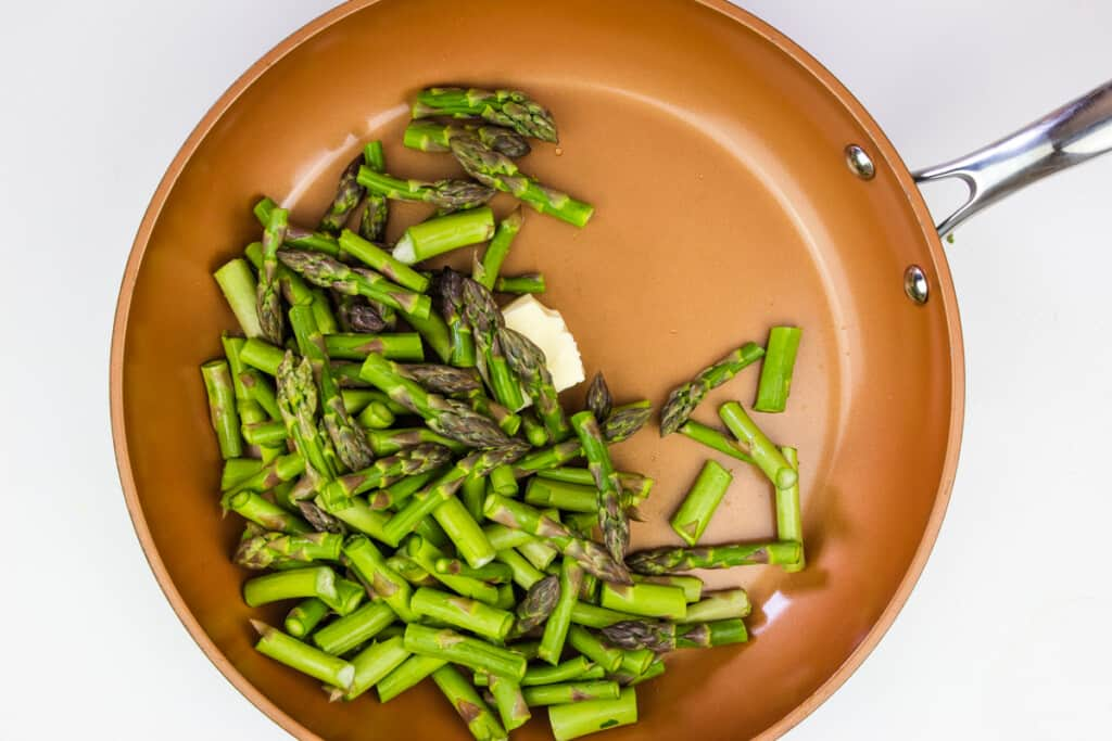 sauteeing the asparagus in butter