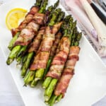 bacon-wrapped grilled asparagus bundles on a plate