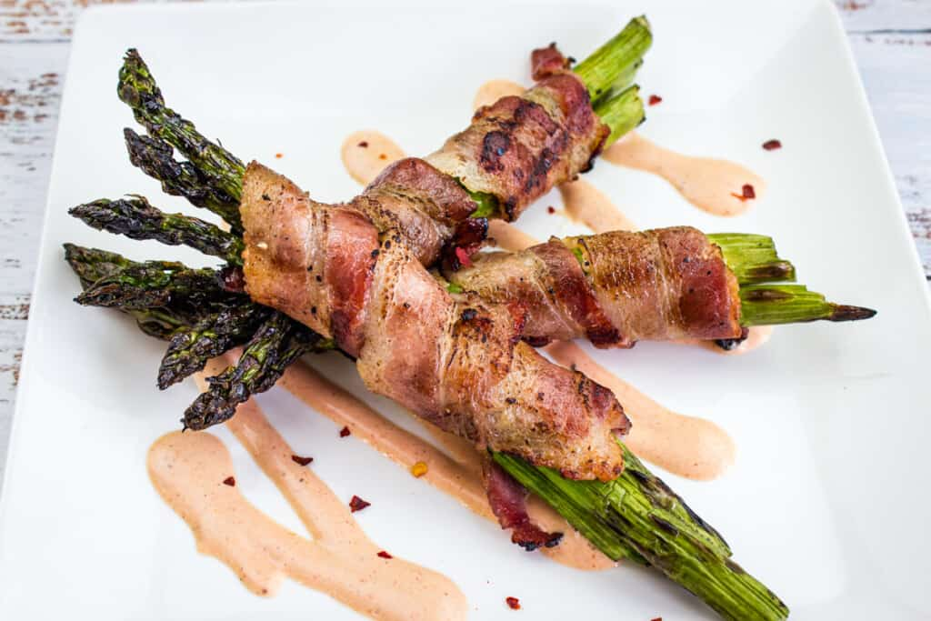 bacon-wrapped grilled asparagus on a plate