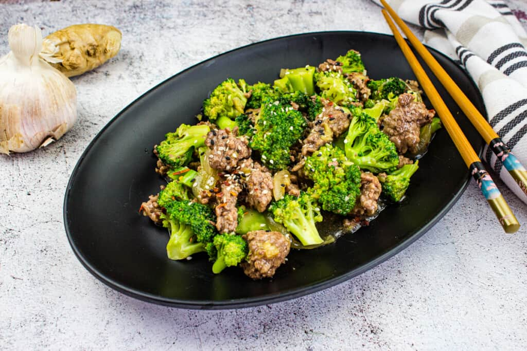 keto ground beef and broccoli on a black plate