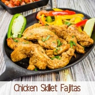 chicken skillet fajitas on a black plate