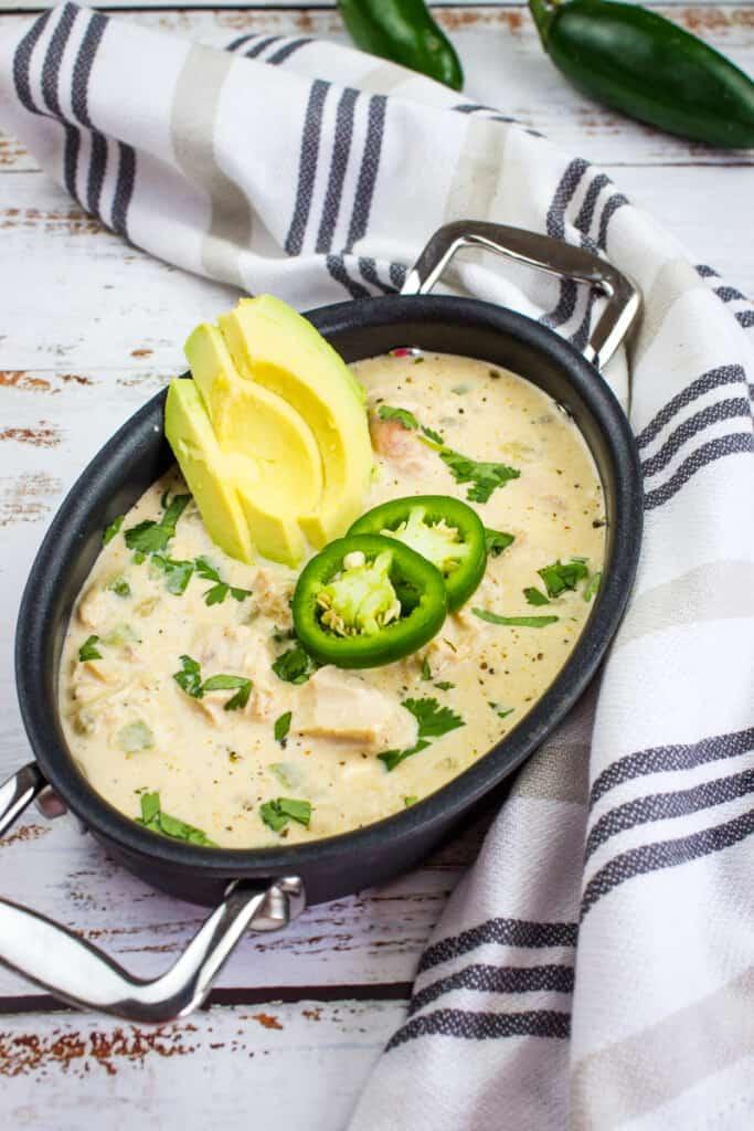 keto white chicken chili in a black dish