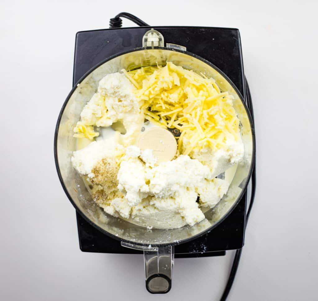 pulsing ricotta dip ingredients in a food processor
