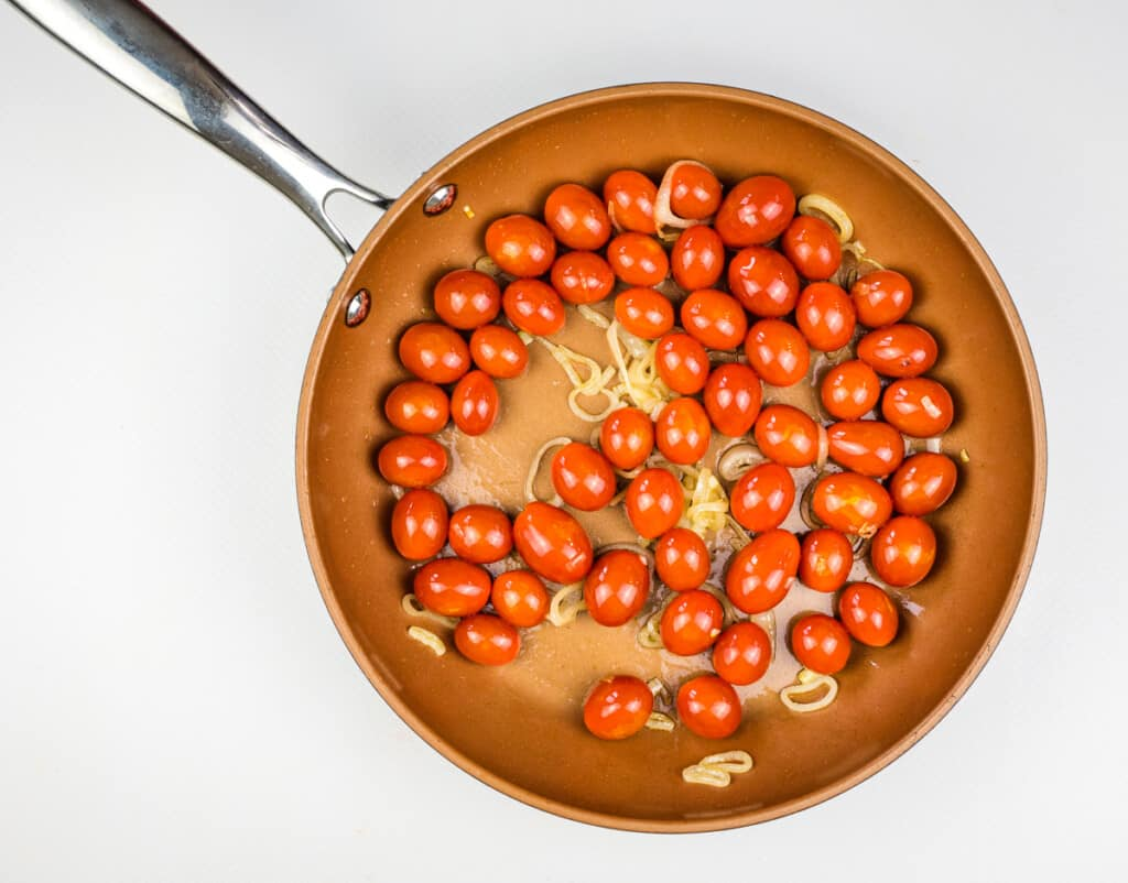 sautee tomatoes and shallots in oil until they burst