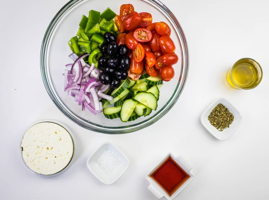 chop everything and get ready to assemble the greek salad