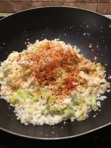 Cauliflower rice ready to cook with celery, onion, spices