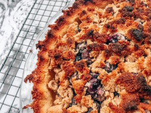 Blueberry pie on a baking rack