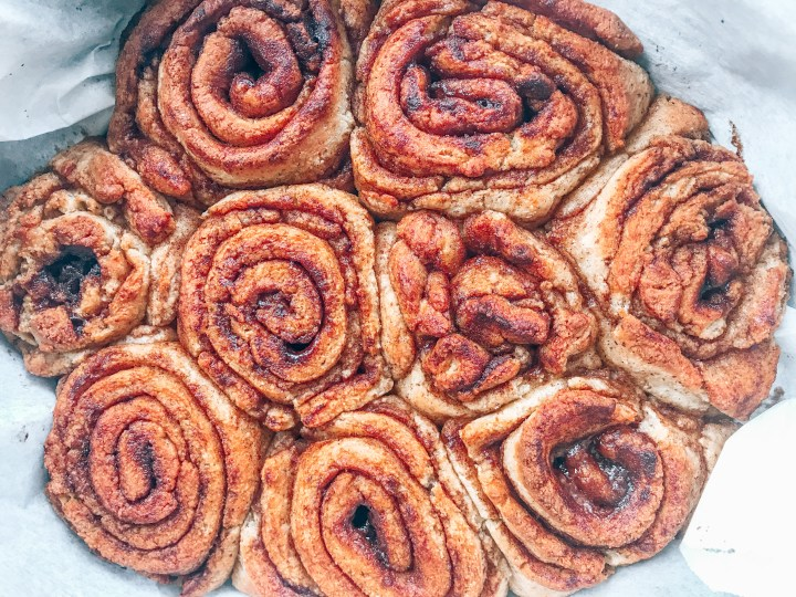 A pan of baked cinnamon rolls without icing