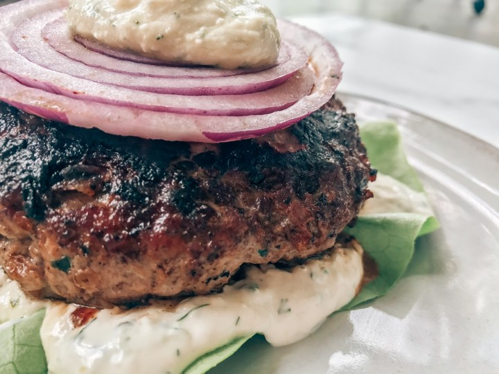 Lamb burger wrapped in butter lettuce with onion and tzatziki