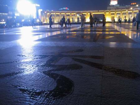Quancheng Square, Jinan, northeastern China. China's sidewalks are great for writing poetry in calligraphy with a wet mop, but not always so good for walking on.