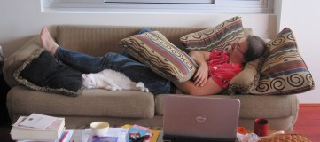 Hubby lounging under the old sofa cushions