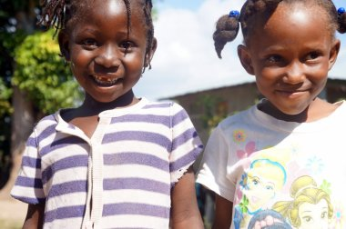 Two young girls at Eco-Village #1 in the Central Plateau. Their joy and openness was a blessing.