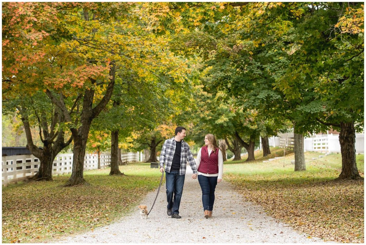 Fall puppy engagement photo at Shaker Village in Harrodsburg, Kentucky.