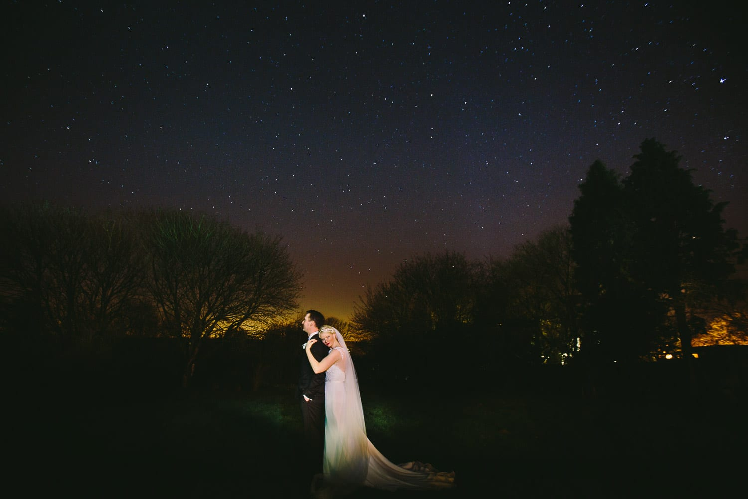 bride and groom portrait under the stars