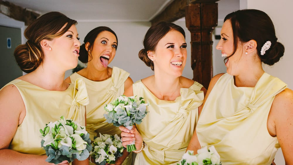 The bridesmaids laughing and pulling faces at Sopley Mill
