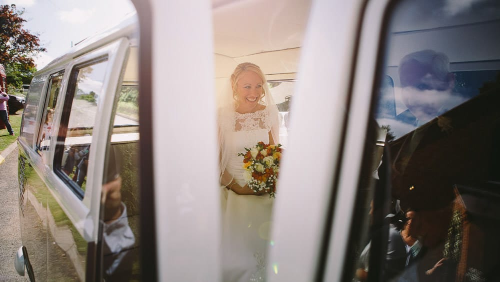Bride arrives for her military wedding in a VW Camper