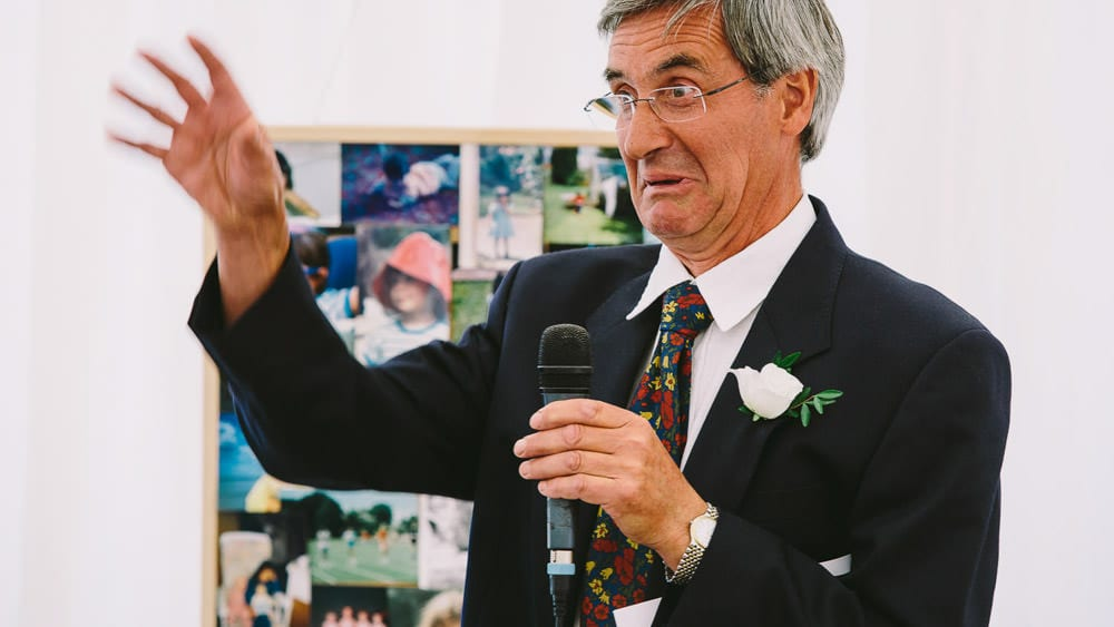 Brides father doing his speech at marquee wedding