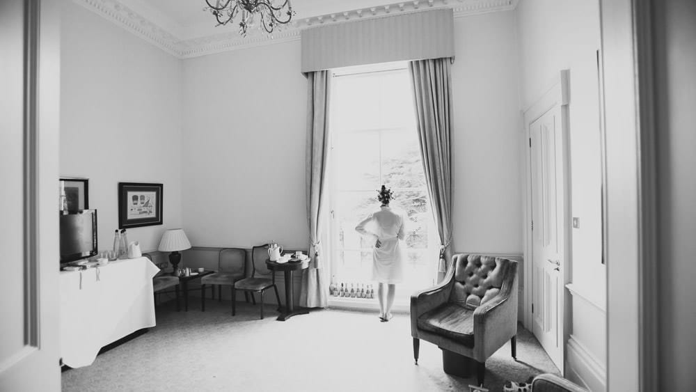 Bride looking out of window at Bath Spa Hotel
