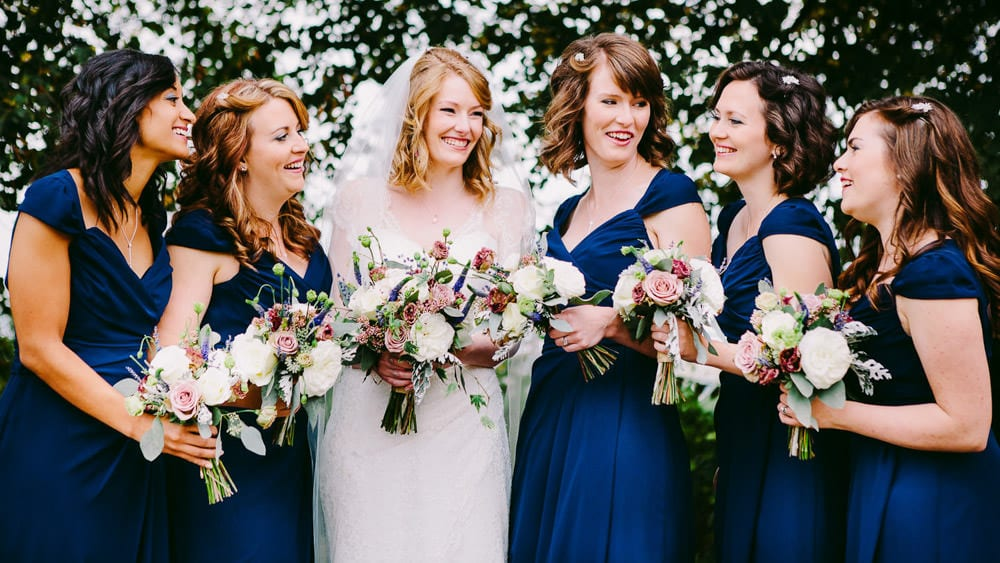 A bride and her bridesmaids laughing