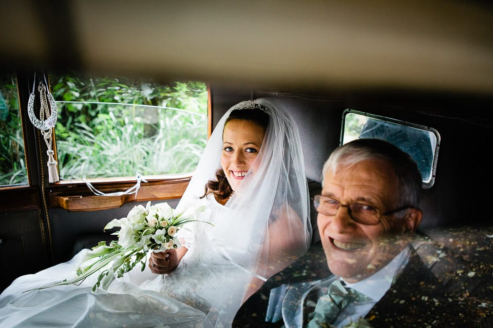 Bride arrives at St. James the Great Church in Dauntsey, Wiltshire