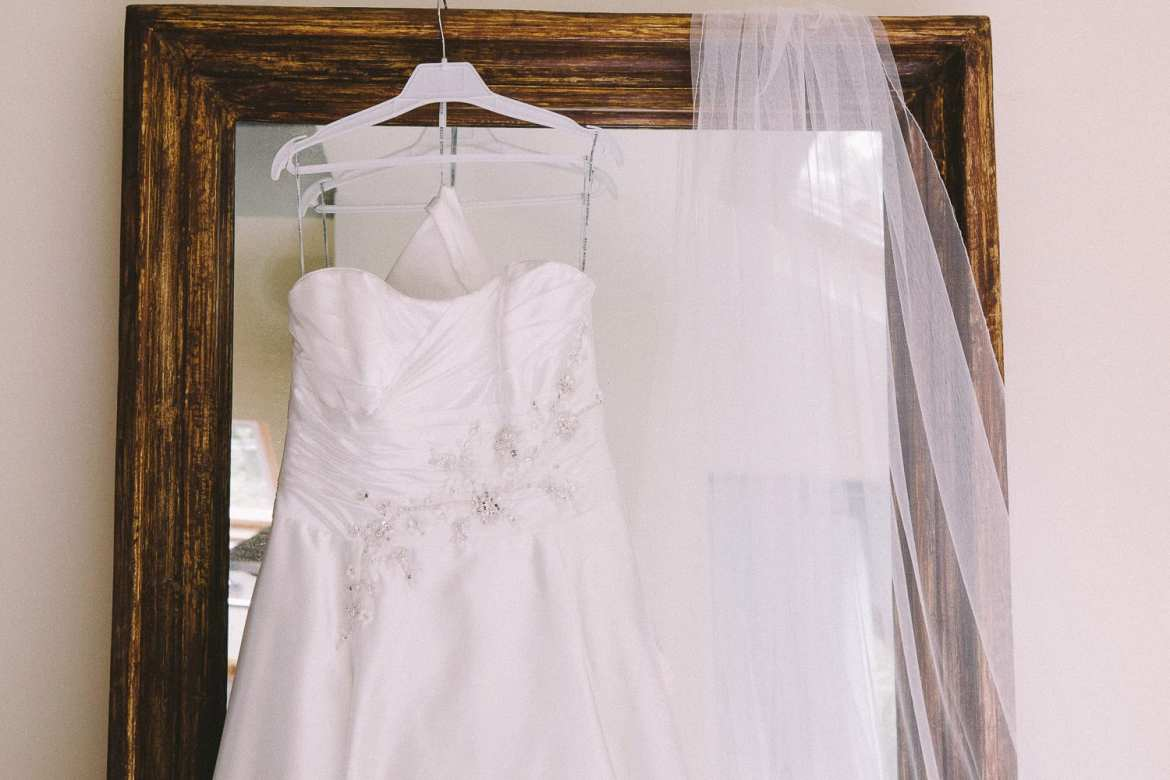 Wedding dress hanging on the mirror