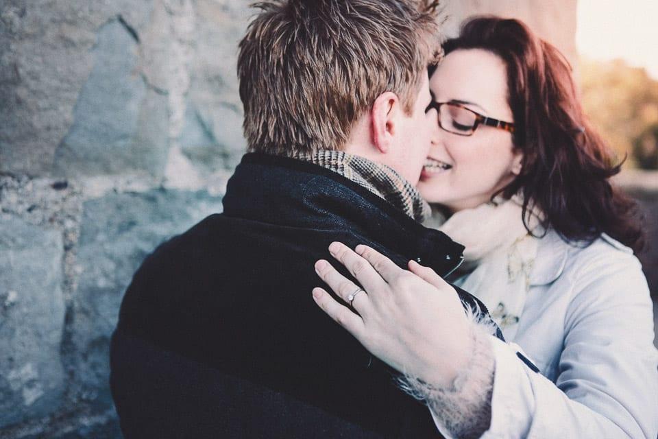 Engaged couple having a hug at Clifton Suspension Bridge