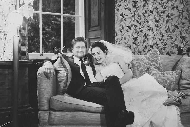 Bride and groom on sofa at Kings Weston House