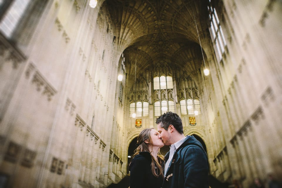 Engaged couple kiss in Wills memorial building