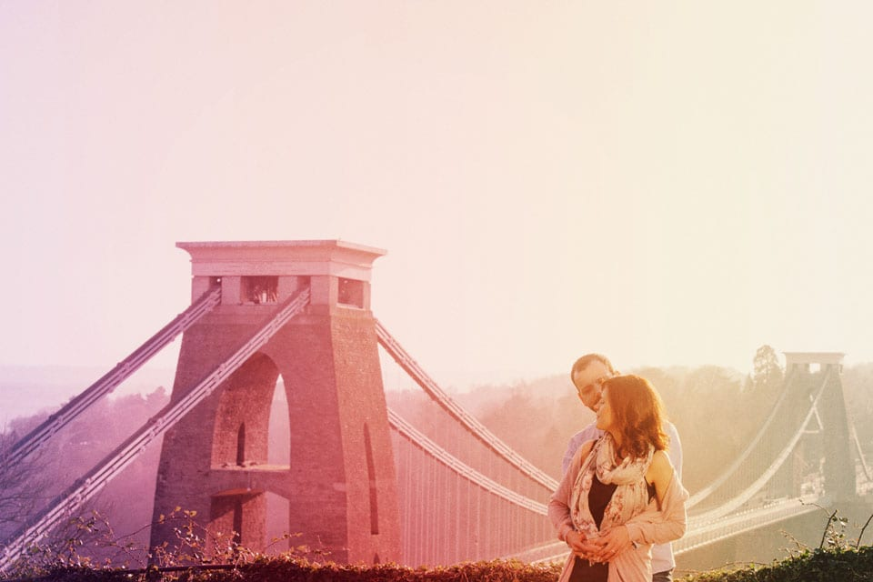 Sunset image of engaged couple at Clifton Suspension Bridge