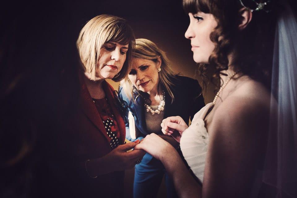 Guests looking at wedding ring