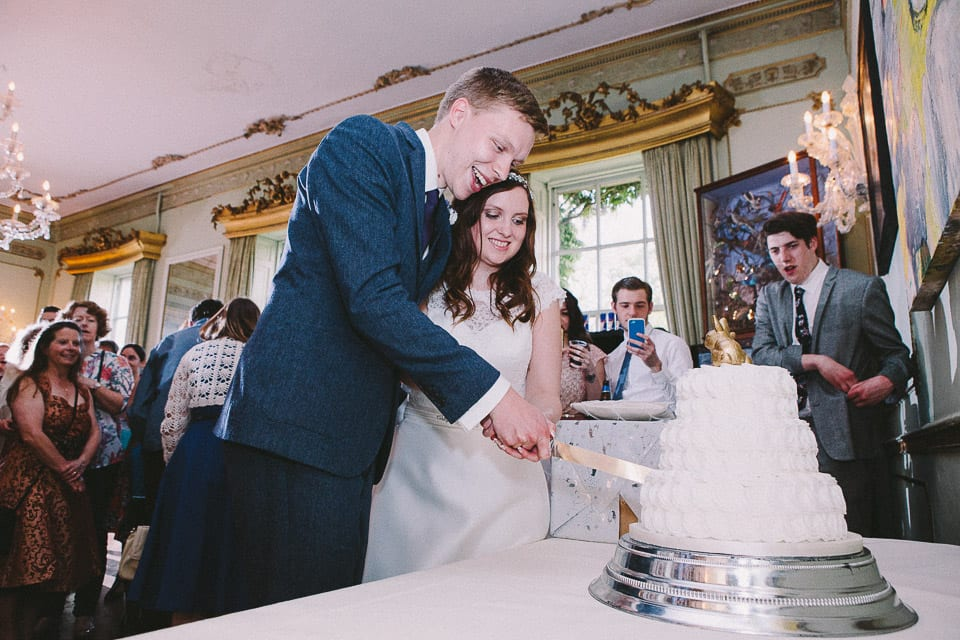 cutting cake at a wedding