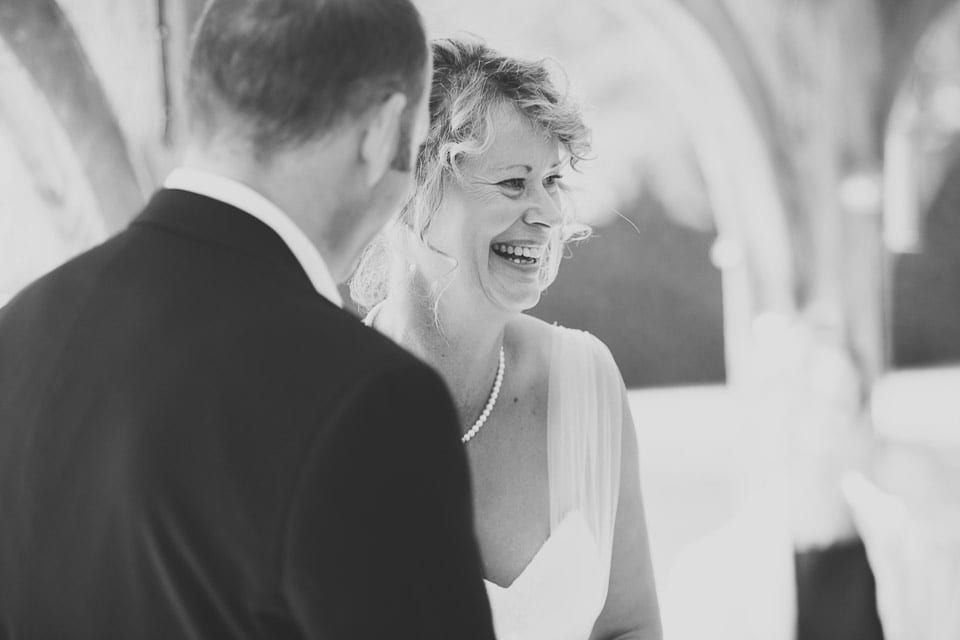 Black and white image of bride laughing