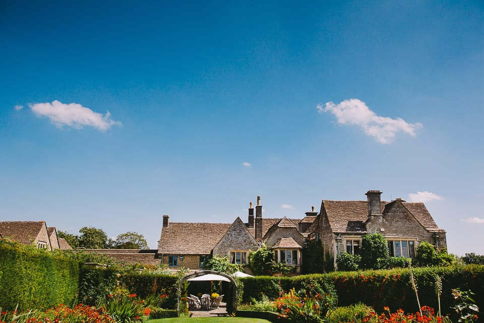Sunny view of Whatley Manor from the gardens