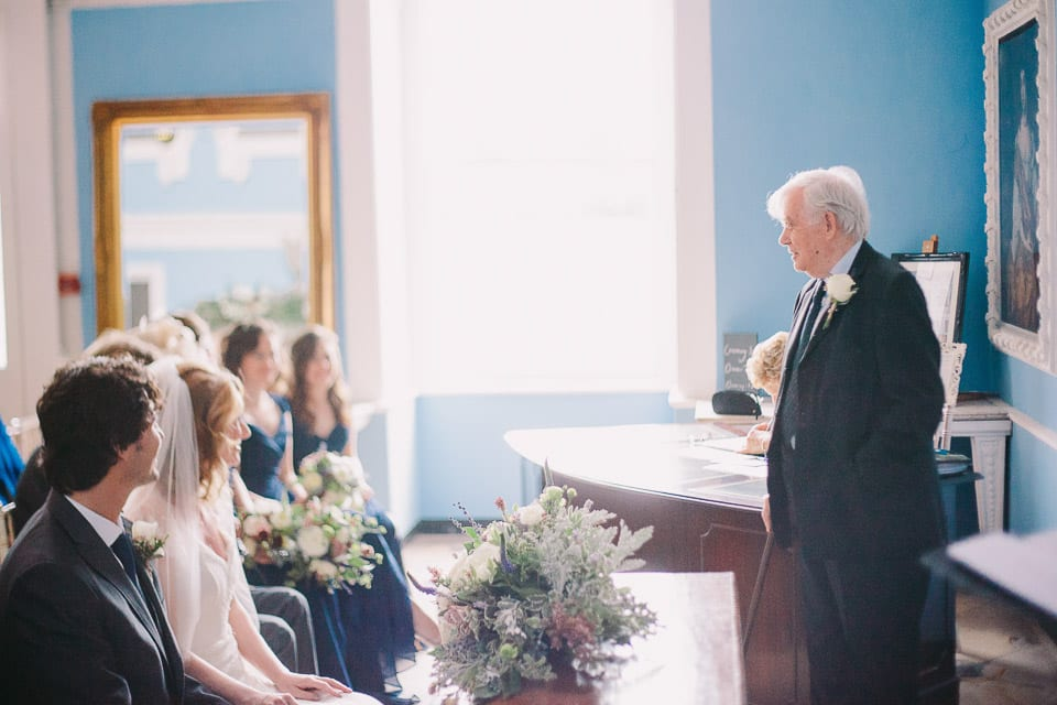 The bride's grandfather speaking at the wedding ceremony