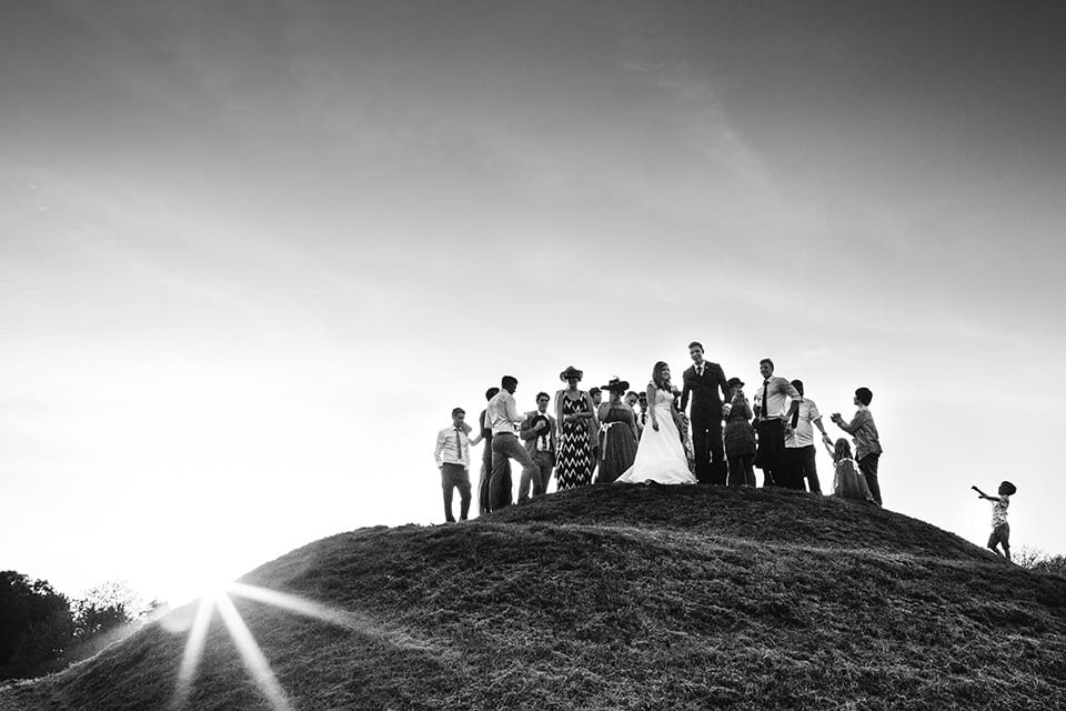 wedding guests on a hill