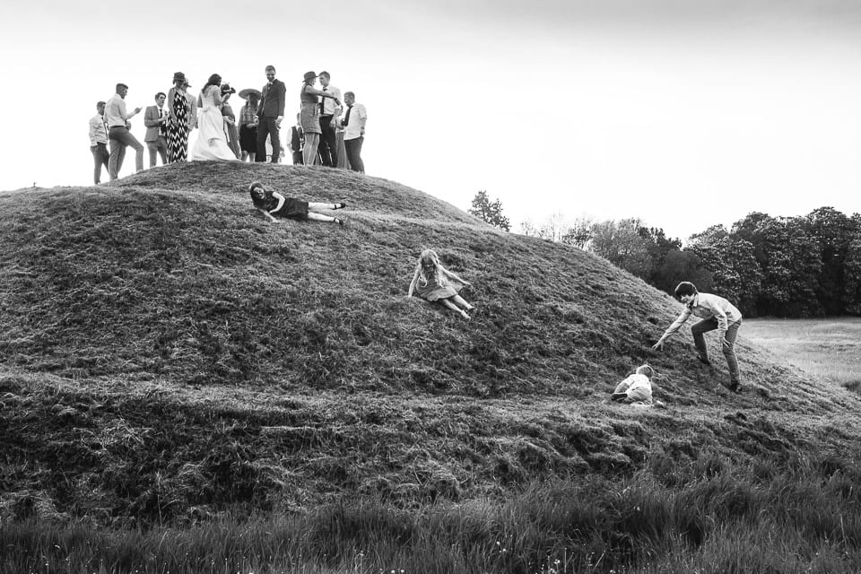wedding guests rolling down hill